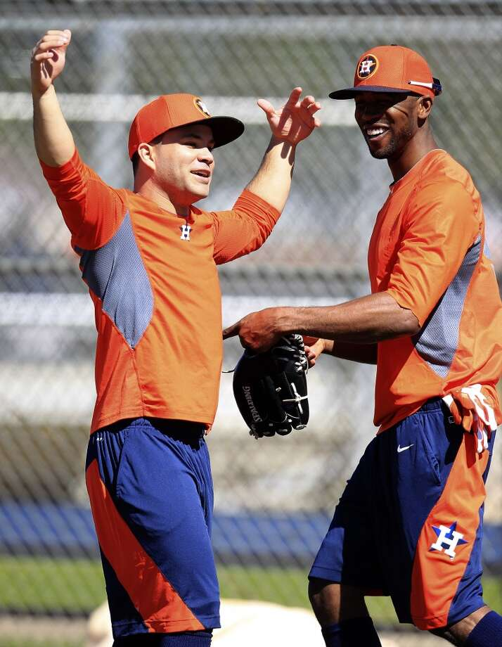 Jose Altuve, left, and Dexter Fowler, right, horse around at batting practice during workouts for early-arriving position players. Photo: Karen Warren, Houston Chronicle