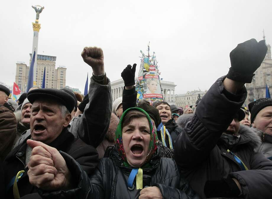 Protesters in Kiev's Independence Square pledge to keep up pressure in their opposition to the rule of Ukrainian President Viktor Yanukovych. Photo: Sergei Chuzavkov, Associated Press