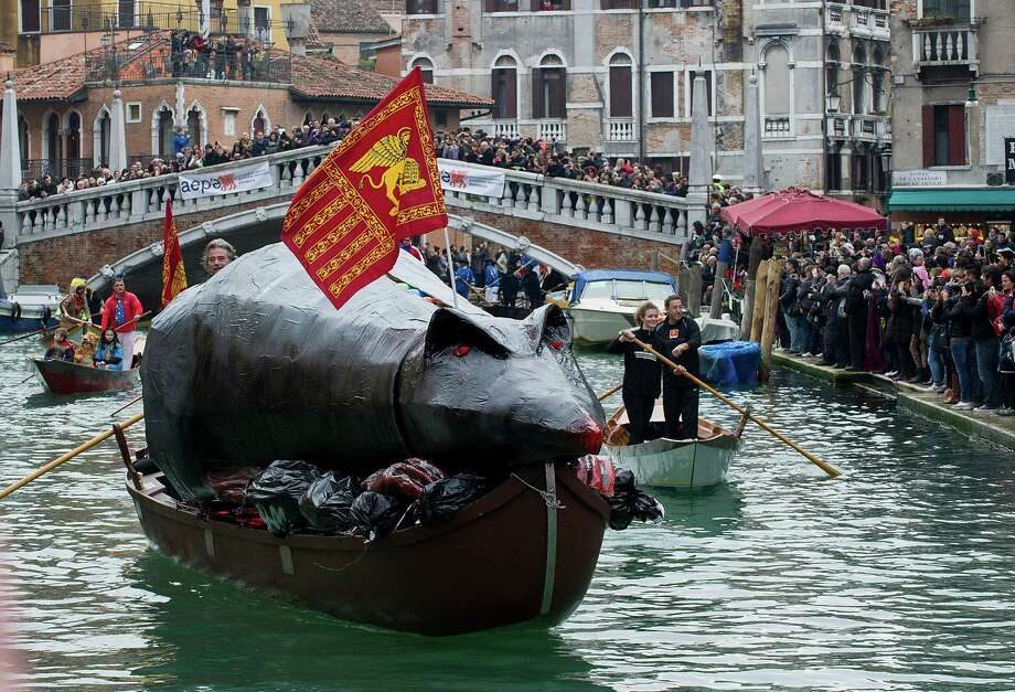 "The ""Pantegana""  (Big Rat) sails on the Canaregio Canal for the traditional regatta which officially opens the Carnival  on February 16, 2014 in Venice, Italy. The 2014 Carnival of Venice will run from February 15 to March 4 and includes a program of gala dinners, parades, dances, masked balls and music events. Photo: Marco Secchi, Getty Images / 2014 Getty Images"