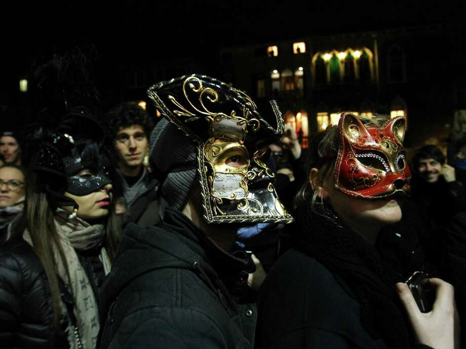 Thousands of people attend the opening ceremony of the Carnival of Venice 2014 on February 15, 2014 in Venice, Italy. People wearing costumes and masks enjoy the water procession on the Cannaregio Canal. The 2014 Carnival of Venice will run from February 15 to March 4, 2014. Photo: Anadolu Agency, Getty Images / 2014 Anadolu Agency