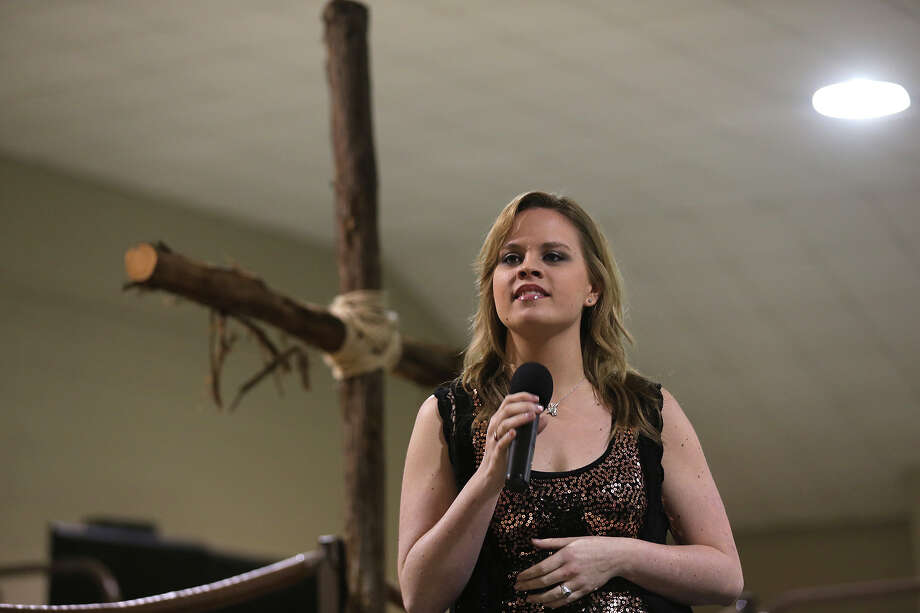 "Holly Tucker sings during the San Antonio Stock Show and Rodeo Cowboy Church services, Sunday, Feb. 16, 2014. Tucker placed sixth when she competed in the television show, ""The Voice"" in 2013. Photo: JERRY LARA, San Antonio Express-News / © 2014 San Antonio Express-News"