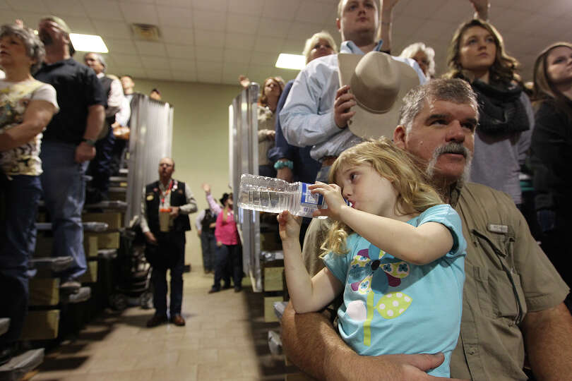 Scott Schrader and his daughter, Tracy, 5, attend the San Antonio Stock Show and Rodeo Cowboy Church
