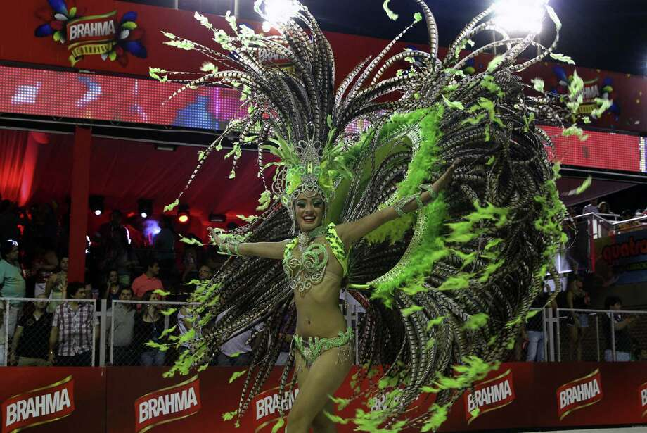 """Dancers perform during carnival in Encarncion, 375 km south of Asuncion on February 15, 2014. The """"Llamadas"""" is Paraguay's biggest carnival parade, in which """"comparsas,"""" groups of dancers and drummers compete.  Photo: NORBERTO DUARTE, Getty Images / 2014 AFP"""