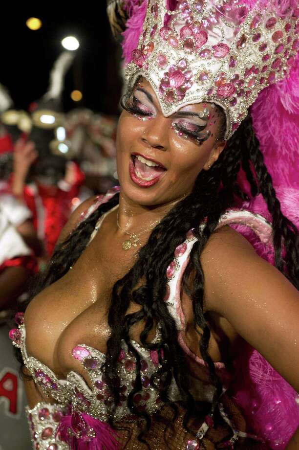 """A dancer performs in a street of the Sur neighbourhood in Montevideo, during the second night of the """"Llamadas"""" (Calls) parade on February 14, 2014. The """"Llamadas"""" is Uruguay's biggest carnival parade, in which """"comparsas"""" -- groups of dancers and drummers of the traditional """"candombe"""" music -- compete during two nights of parades.  Photo: PABLO PORCIUNCULA, Getty Images / 2014 AFP"""