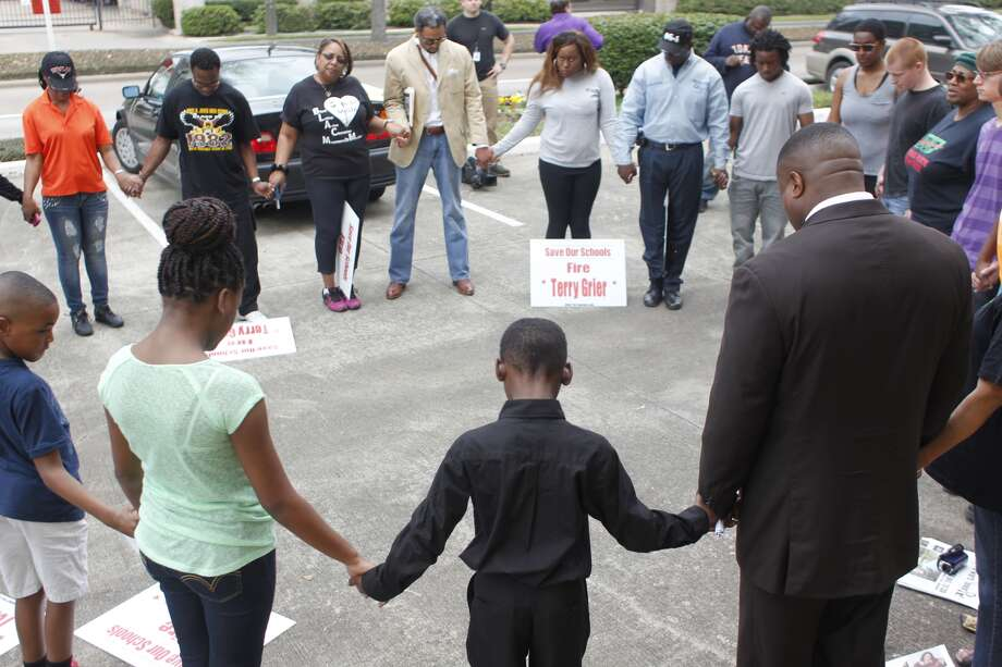 About two dozen leaders in the black community protested Sunday outside HISD Superintendent Terry Grier's home, calling for his firing for plans to close schools their neighborhoods. (Johnny Hanson / Houston Chronicle)