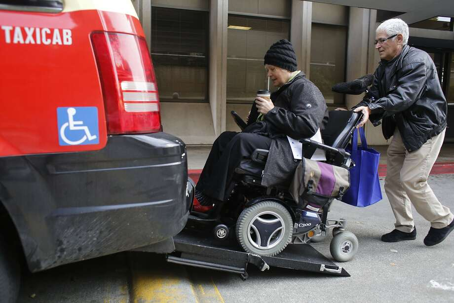 "With the help of a cabdriver who wished to remain anonymous, Peggy Costa boards a wheelchair-accessible Arrow Cab. ""The ramp taxis are totally critical to my life,"" she said. Photo: Mike Kepka, The Chronicle"