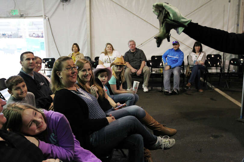 People react as Organization for Bat Conservation Executive Director Rob Mies holds a Straw colored