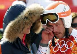 Third-placed Bode Miller (R) of the U.S. cries after the men's alpine skiing Super-G competition during the 2014 Sochi Winter Olympics at the Rosa Khutor Alpine Center February 16, 2014.  REUTERS/Mike Segar (RUSSIA - Tags: SPORT SKIING OLYMPICS TPX IMAGES OF THE DAY)