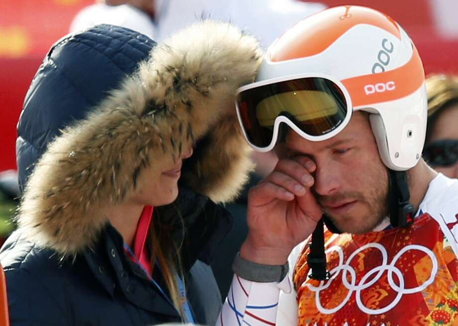 American skier Bode Miller wipes away tears after his bronze-medal run in the super-G. Photo: Mike Segar, Reuters