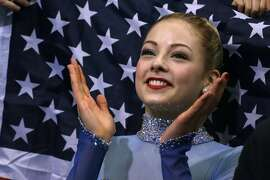 FILE - In a Sunday, Feb. 9, 2014 file photo, Gracie Gold of the United States applauds in the results area after competing in the women's team free skate figure skating competition during the 2014 Winter Olympics, in Sochi, Russia. Some Olympians are turning over their social media accounts to sponsors, agreeing to quotas of postings on Twitter and Facebook and letting other people send commercial messages in their name. The agents for US figure skaters Gold and Ashley Wagner both say sponsors draft some of their tweets, plugging their brands. (AP Photo/Darron Cummings, Pool)