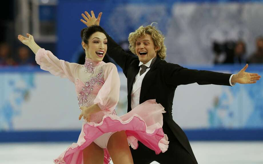 "Meryl Davis and Charlie White spin across the ice in perfect unison while skating to ""My Fair Lady"" in the short program. Photo: Alexander Demianchuk, Reuters"
