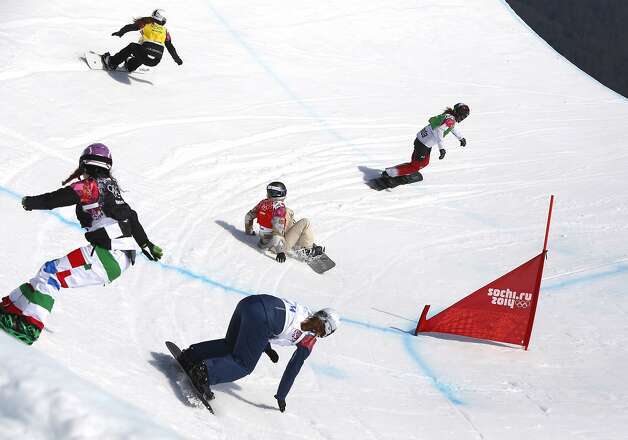 Lindsey Jacobellis of the United States crashes in the women's snowboard cross semifinal at the Rosa Khutor Extreme Park, at the 2014 Winter Olympics, Sunday, Feb. 16, 2014, in Krasnaya Polyana, Russia. The other riders are, from left, Italy's Michela Moioli,  Bulgaria's Alexandra Jekova, top, Britain's Zoe Gillings and at right the semifinal winner Canada's Dominique Maltais.  (AP Photo/Sergei Grits) Photo: Sergei Grits, Associated Press