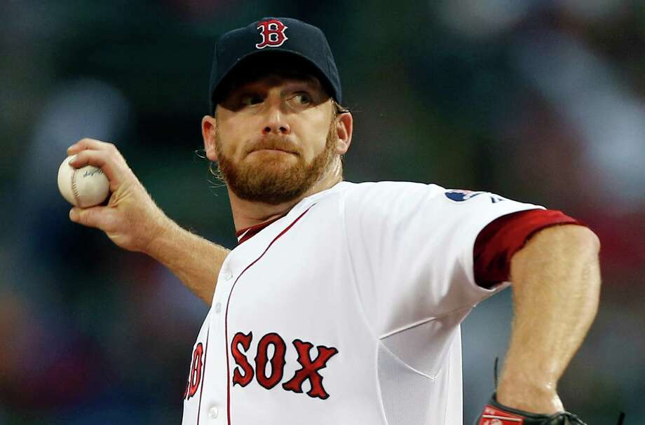Boston Red Sox's Ryan Dempster pitches in the first inning of a baseball game against the Seattle Mariners in Boston, Thursday, Aug. 1, 2013. (AP Photo/Michael Dwyer) ORG XMIT: MAMD102 Photo: Michael Dwyer / AP