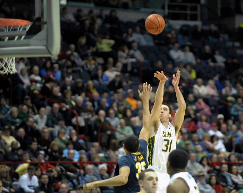 Brett Bisping of Siena puts up a shot during the Siena and Canisius mena€™s basketball game at the  Times Union Center on Sunday, Feb. 16, 2014 in Albany, NY.   (Paul Buckowski / Times Union) Photo: Paul Buckowski / 00025723A