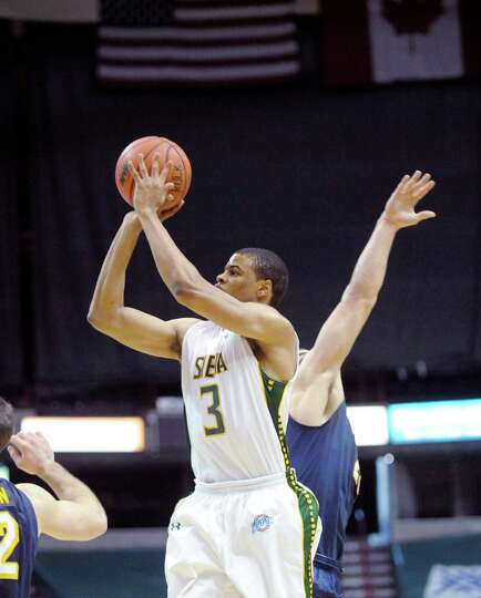Ryan Oliver of Siena puts up a shot during the Siena and Canisius mena€™s basketball game at the