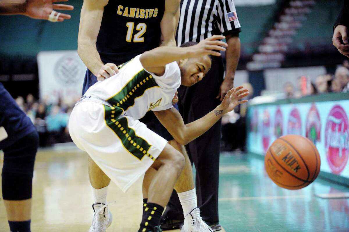 Evan Hymes of Siena loses the ball out of bounds during the Siena and Canisius mena€™s basketball game at the Times Union Center on Sunday, Feb. 16, 2014 in Albany, NY. (Paul Buckowski / Times Union)