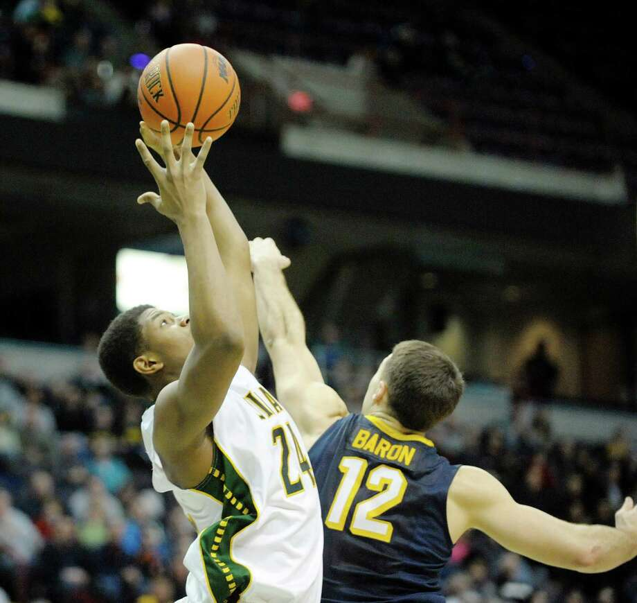 Lavon Long of Siena grabs an offensive rebound during the Siena and Canisius mena€™s basketball game at the  Times Union Center on Sunday, Feb. 16, 2014 in Albany, NY.   (Paul Buckowski / Times Union) Photo: Paul Buckowski / 00025723A