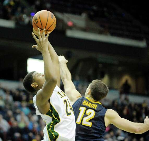 Lavon Long of Siena grabs an offensive rebound during the Siena and Canisius mena€™s basketball ga