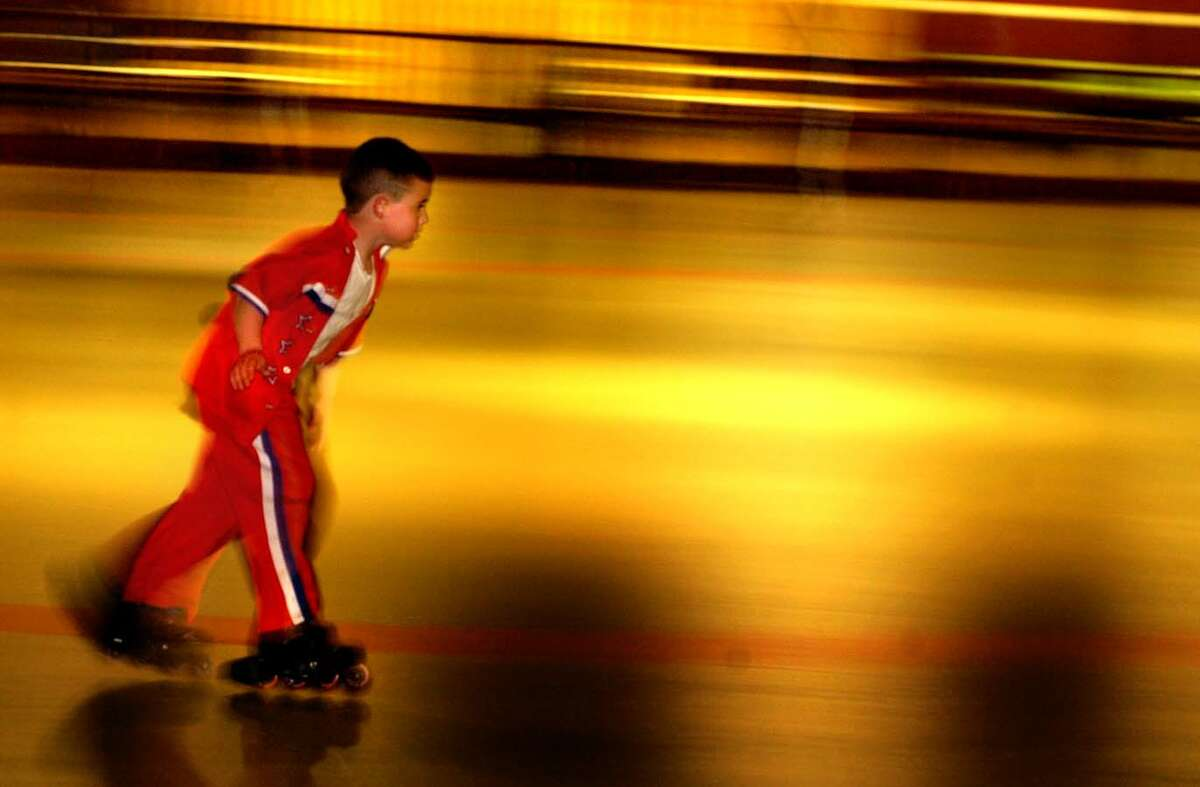 Times Union photo by STEVE JACOBS , 4/13/04, Clifton Park,NY-- SPEEEEEEEEED -- Jacob Petralia, 7, from Schyulerville,NY, speeds aroung the Guptill Arena on his rollerskates as he and many others in the Capital Region stayed indoors away from the rainfall to spend their afternoon, Tuesday, April 13,2004 ( for story)