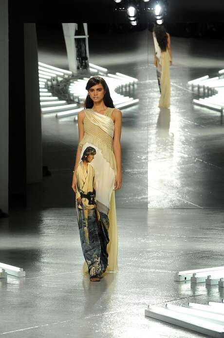 Models present creations from Rodarte's fall-winter 2014 collection — featuring Luke, the Death Star, Yoda and C-3PO — during New York Fashion Week. Photo: Diane Bondareff, Associated Press