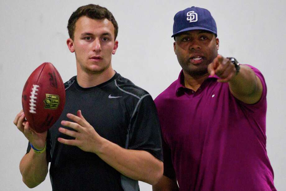 Trainer George Whitfield Jr., right, says former A&M QB Johnny Manziel has ideal vision and awareness on the field. Photo: Brett Coomer, Staff / © 2014 Houston Chronicle