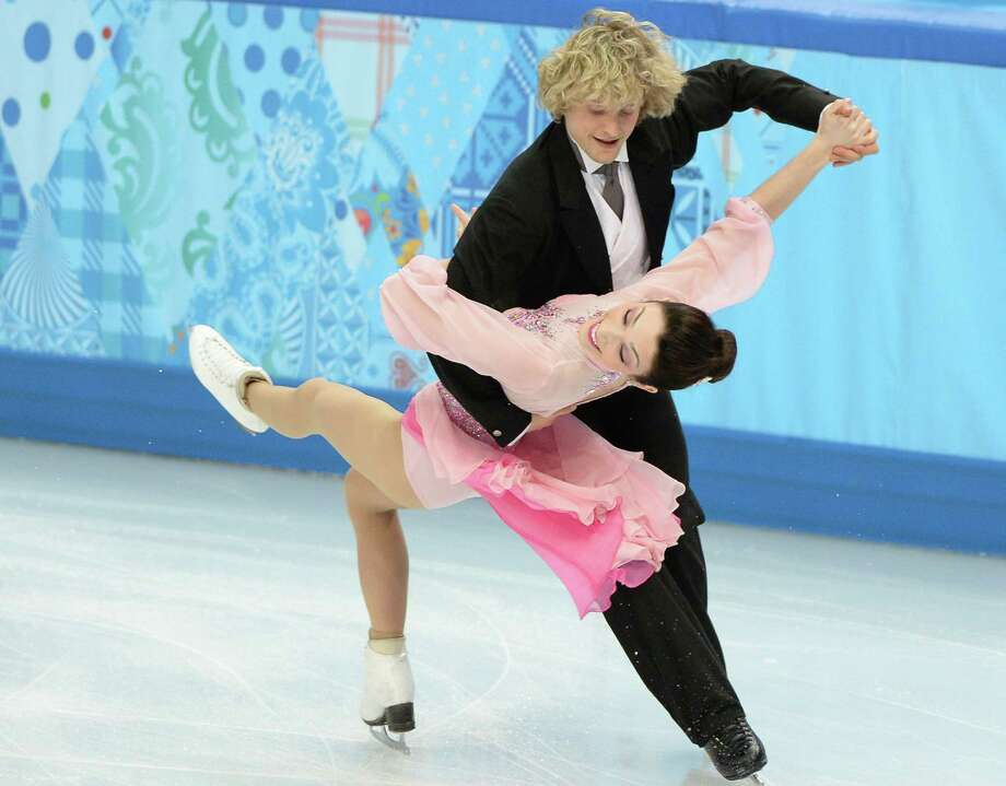 Charlie White and Meryl Davis have the look of Olympic champions, according to the judges. The American pair leads the field heading into today's final portion of the ice dancing event. Photo: Chuck Myers / McClatchy-Tribune News Service / MCT