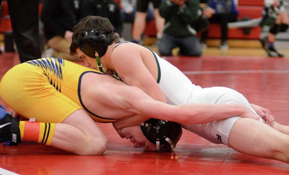 Newtown High Schools Ed Lovely, left, and New Milfords Kyle Lindner wrestle for the SWC championship in the 113 weight class on Sunday Feb. 16, 2104 at Pomperaug High School. Photo: Lisa Weir / The News-Times Freelance