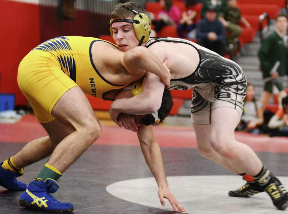 Newtown High Schools James Leuci, left, and Immaculate/Joel Barlows  Emmett LiCastri wrestle for the SWC championship in the 132 weight class on Sunday Feb. 16, 2104 at Pomperaug High School. Photo: Lisa Weir / The News-Times Freelance