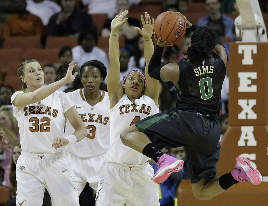 Baylor's Odyssey Sims shoots over Texas defenders (from left) Brady Sanders, Nneka Enemkpali and Krystle Henderson. Photo: Eric Gay / Associated Press / AP