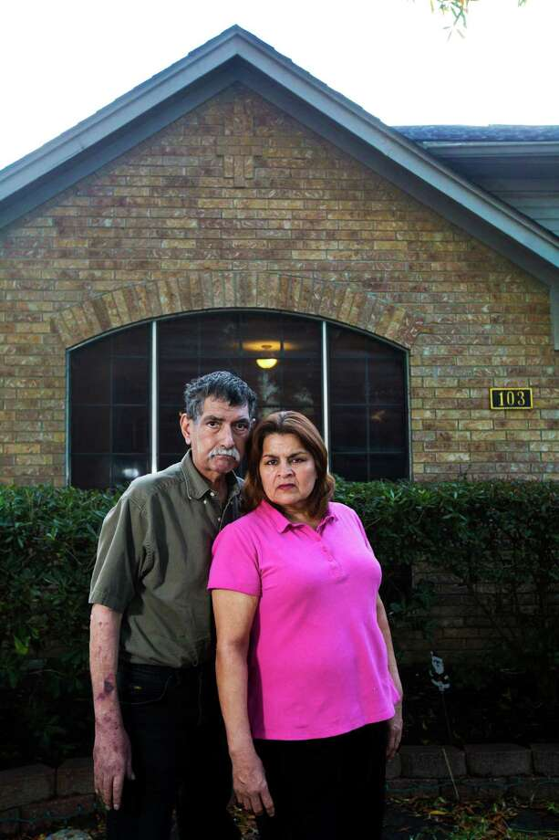 Jose and Dolores Lara say they had no choice but to accept Matt Wiggins' offer to trade their Ike-damaged home in Kemah after a building permit for repairs was denied. Photo: Marie D. De Jeséºs, Staff / © 2014 Houston Chronicle