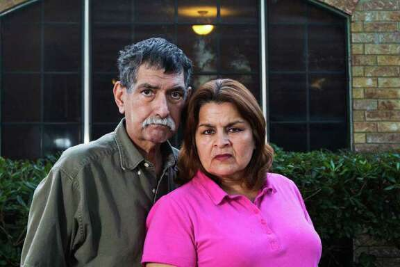 Jose and Dolores Lara say they had no choice but to accept Matt Wiggins' offer to trade their Ike-damaged home in Kemah after a building permit for repairs was denied.