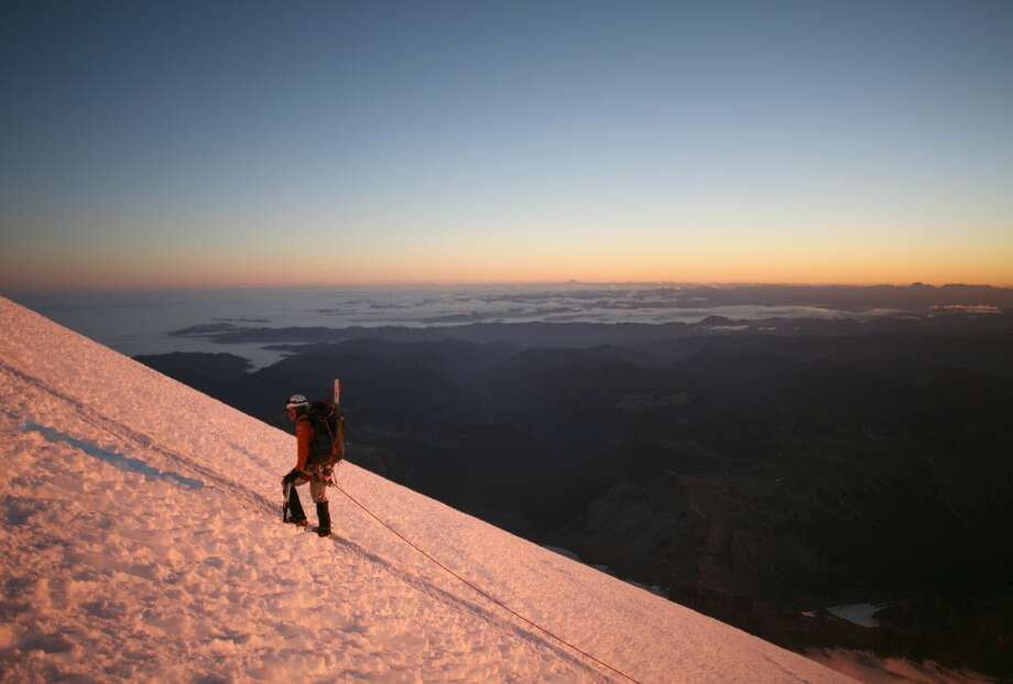 """Climb Mount Rainier: """"You will leave sore from your toes to your temples, you will feel drained, your feet likely will be blistered, and your lungs may feel congested from labored breathing of the thin air at more than 2.7 miles high,"""" P-I writer Greg Johnston wrote of the feat in 2007.So why do it? Photo: Mike Kane, SEATTLE PI"""