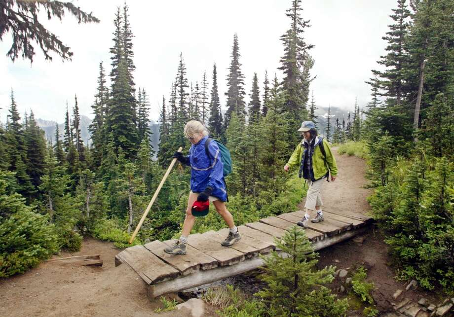 Hike the Wonderland Trail: If climbing isn't your thing, hike this 93-mile trail around Mount Rainier, one of the country's most famous backpacking trips. It's a tough trek through lowland forests and alpine meadows of more than 22,000 feet in elevation gain. Photo: JOHN FROSCHAUER, AP