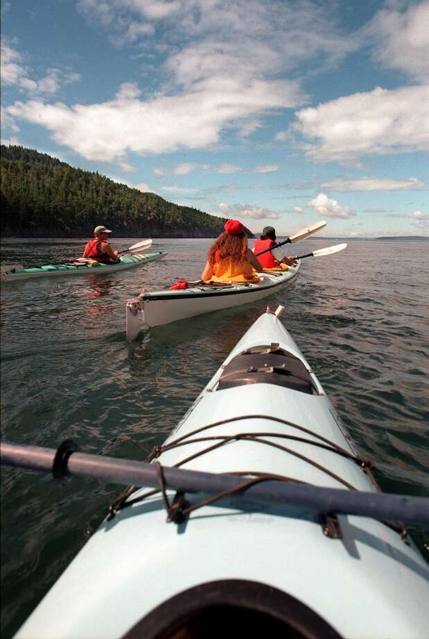 Speaking of the San Juan Islands, they're obviously high on the bucket list. First up, kayak the islands and sneak up on orcas, seals and bald eagles. Photo: P-I File