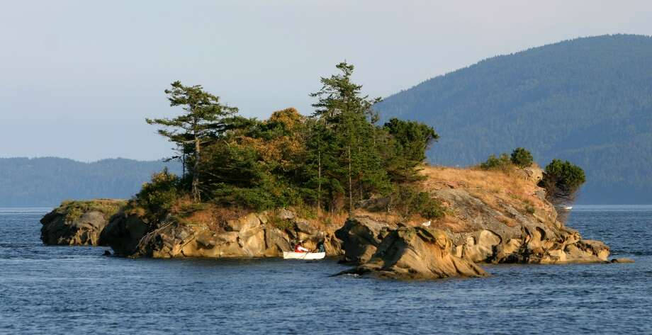 San Juan Islands, part 2: Camp in one of the boat-in-only marine island parks in the San Juans and pitch your tent away from the crowds. Pictured is Sucia Island, one of the prettiest. Photo: Joshua Trujillo, Seattle Post-Intelligencer