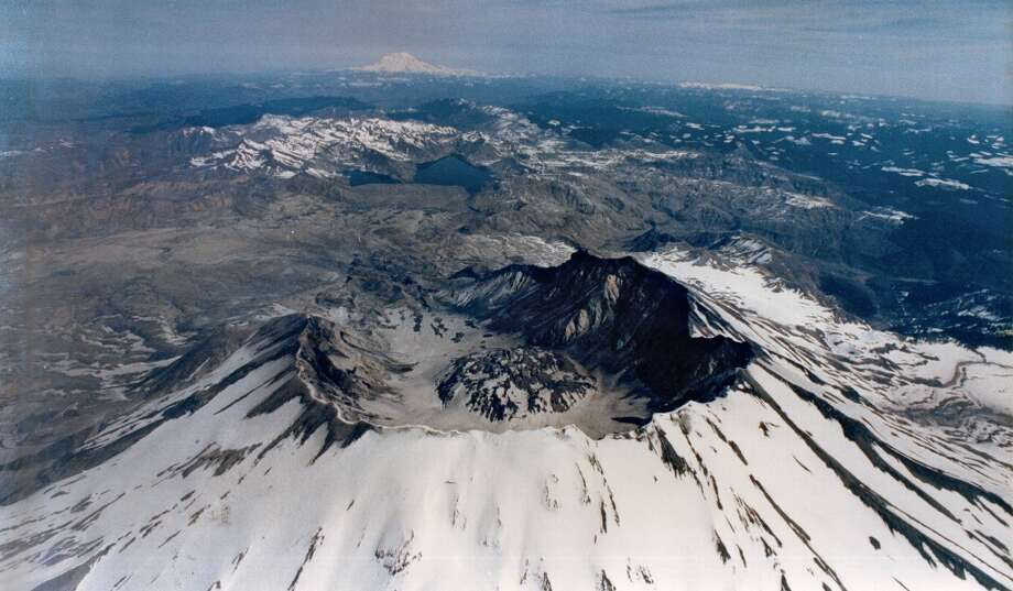 See Mount St. Helens from a helicopter, the best way to see the volcano's devastation and land recovery. (That's Rainier in the background). But there's also terrific hiking, mountain-biking and horseback-riding here. Photo: GRANT M. HALLER