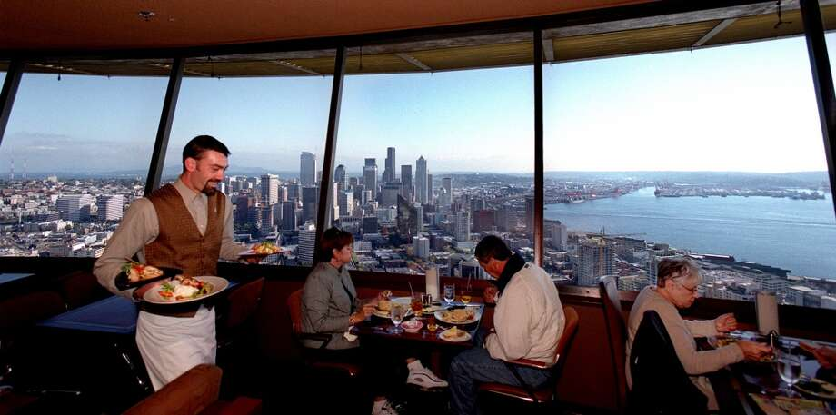 Dine at the top of the Space Needle:Touristy, yes. But the revolving Sky City restaurant is an icon. Photo: SCOTT EKLUND