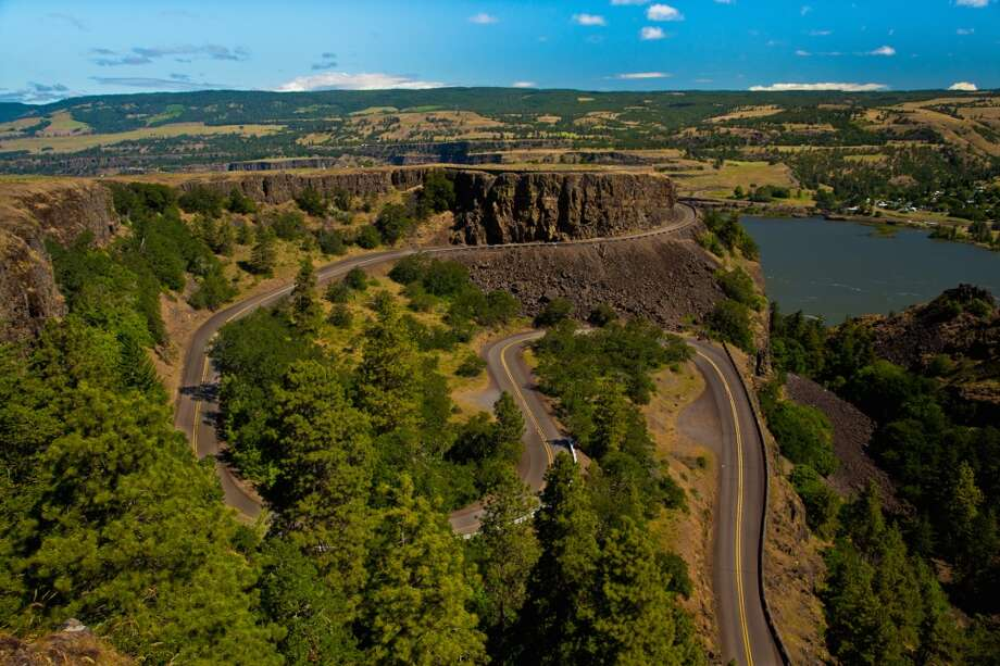 Visit the Columbia Gorge: Carved by ice-age floods, this deep canyon divides Washington and Oregon and stretches more than 80 miles. You can camp, hike and bike here, or just gaze at the dramatic, basalt walls. Photo: 178869, Getty Images