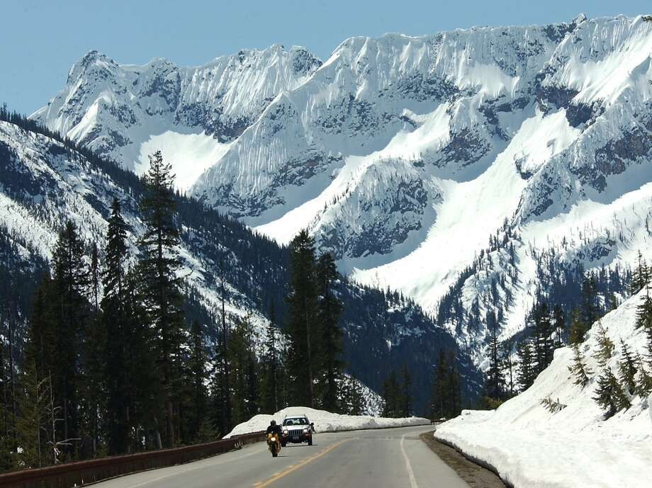 Drive the North Cascades Highway, one of the prettiest drives in the country. You'll pass through Mt. Baker-Snoqualmie National Forest and North Cascades National Park, and see snow-capped peaks, historic dams and alpine lakes. Photo: JEFF LARSEN, PI