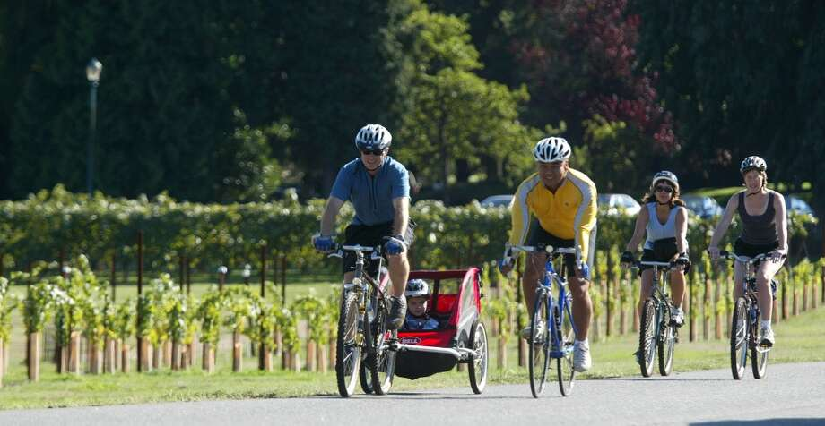 Tour Woodinville's wine country: Visit Chateau Ste. Michelle, Columbia Winery, Redhook Ale Brewery and many other wineries in the lush, green Sammamish River Valley. In the summer, include a nice bike ride on the Sammamish River Trail. Photo: JOSHUA TRUJILLO, SEATTLE POST-INTELLIGENCER