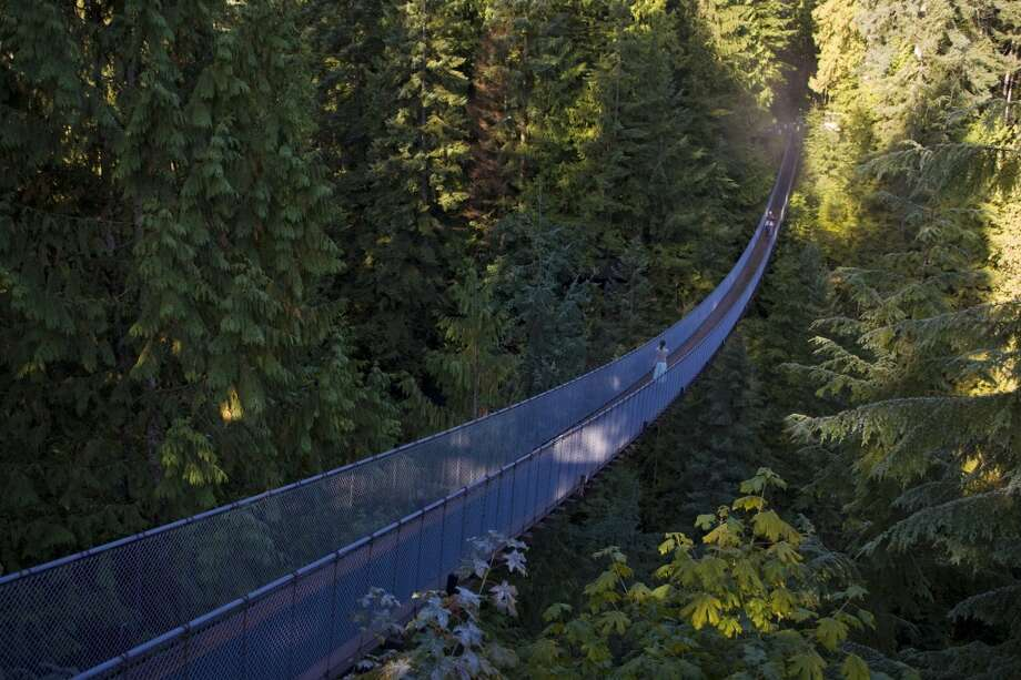 Walk across the famous Capilano Suspension Bridge in North Vancouver, Canada. Apologies to Vancouver and Canada in this bucket list; there's a ton of terrific things to do there that we ran out of time to include. Photo: George Rose, Getty Images