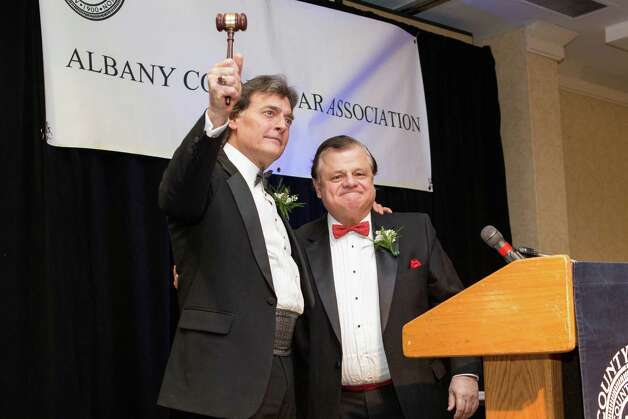 Peter G. Crummey accepts the president's gavel from Professor Michael J. Hutter, Albany Law School. (Colleen Piccolino)