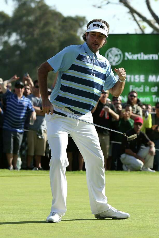 PACIFIC PALISADES, CA - FEBRUARY 16:  Bubba Watson celebrates his birdie putt on the 18th green to win the final round of the Northern Trust Open at the Riviera Country Club on February 16, 2014 in Pacific Palisades, California.  (Photo by Jeff Gross/Getty Images) ORG XMIT: 458228279 Photo: Jeff Gross / 2014 Getty Images