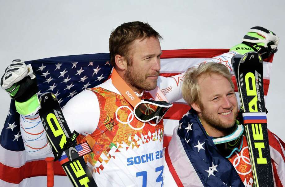 Bode Miller (left) endured the death of his brother, a custody fight and knee surgery to win the bronze medal in the super-G. Teammate Andrew Weibrecht, who won silver, endured four operations and at one point lost funding from the U.S. ski team. Photo: Ezra Shaw / Getty Images / 2014 Getty Images