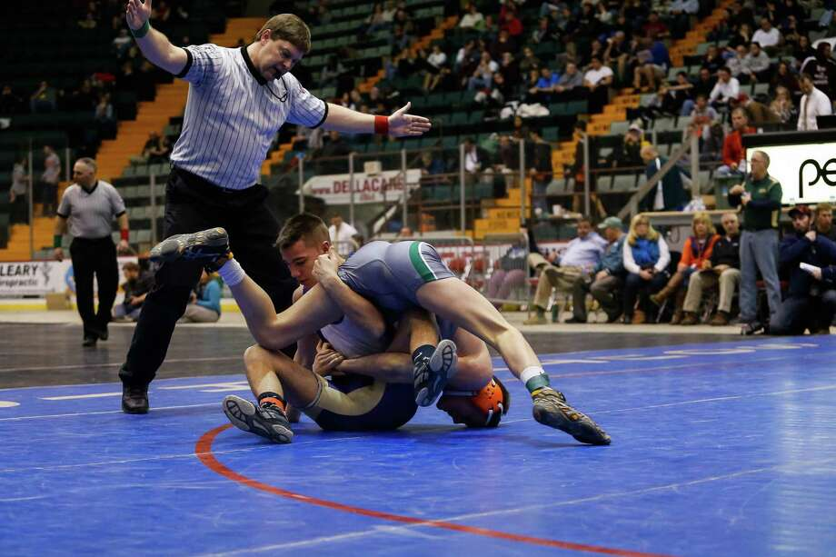 Amsterdam's Brandon Lapi, left, wrestles Shen's Kevin Parker in the 138lb. class Division 1 final during the Section II Wrestling Tournament at the Glens Falls Civic Center on Sunday, Feb. 16, 2014 in Glens Falls, N.Y. (Dan Little/ Special to the Times Union) Photo: Dan Little / Dan Little