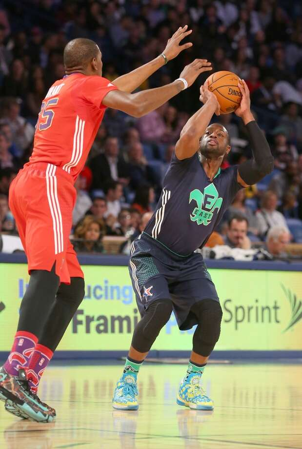 Dwyane Wade #3 of the Heat takes a shot as Kevin Durant #35 of the Thunder defends. Photo: Ronald Martinez, Getty Images