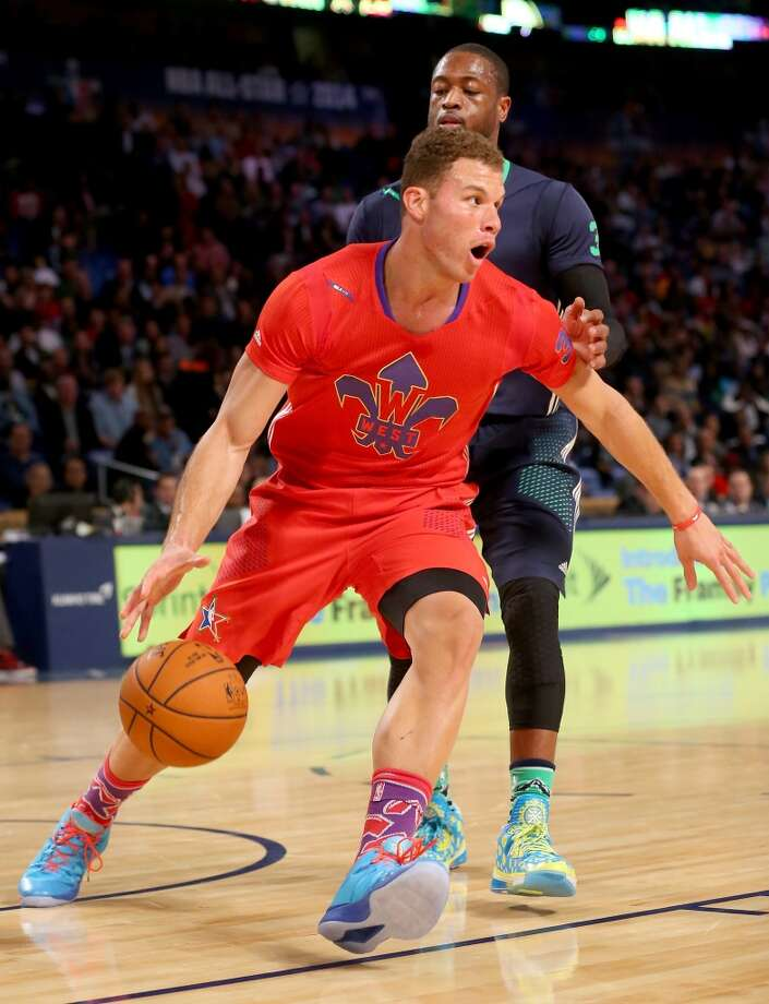 Blake Griffin #32 of the Clippers takes the ball as Dwyane Wade #3 of the Heat defends. Photo: Ronald Martinez, Getty Images