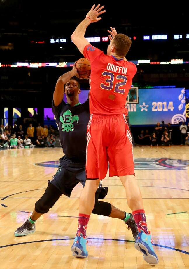 Chris Bosh #1 of the Heat tries to get past Blake Griffin #32 of the Clippers. Photo: Christian Petersen, Getty Images