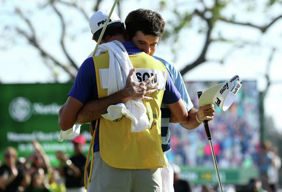 Bubba Watson (back) hugs caddie Ted Scott after winning the Northern Trust Open at Riviera Country Club. Watson's 7-under 64 gave him a two-shot victory over Dustin Johnson for his first win in 22 months. Photo: Jeff Gross / Getty Images / 2014 Getty Images