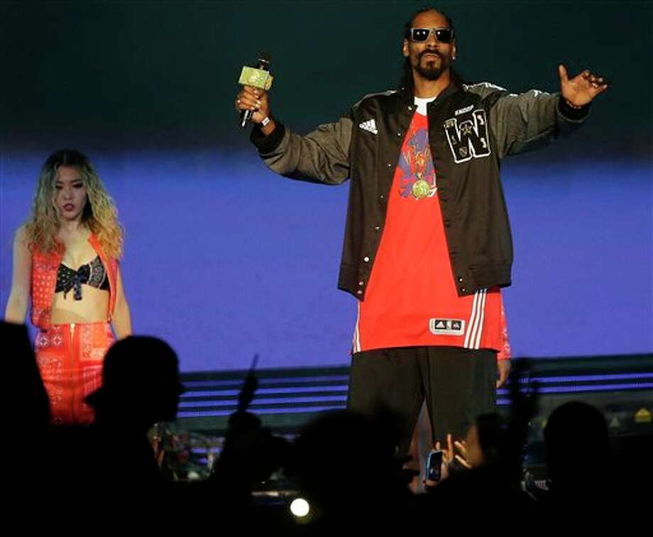 Rapper Snoop Dog performs before the NBA All Star basketball game, Sunday, Feb. 16, 2014, in New Orleans. (AP Photo/Gerald Herbert) Photo: Gerald Herbert, AP / AP